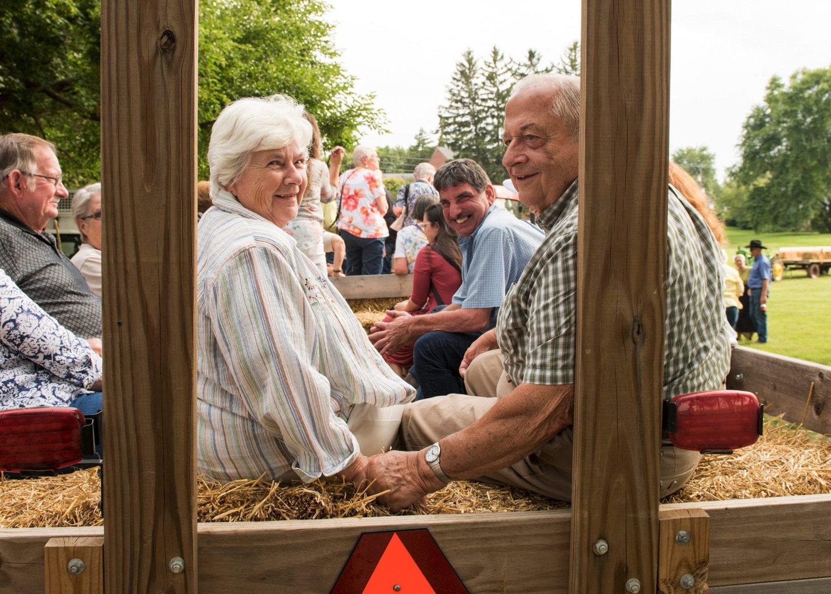 Couple on cornfield banquet hayride in Bird-in-Hand