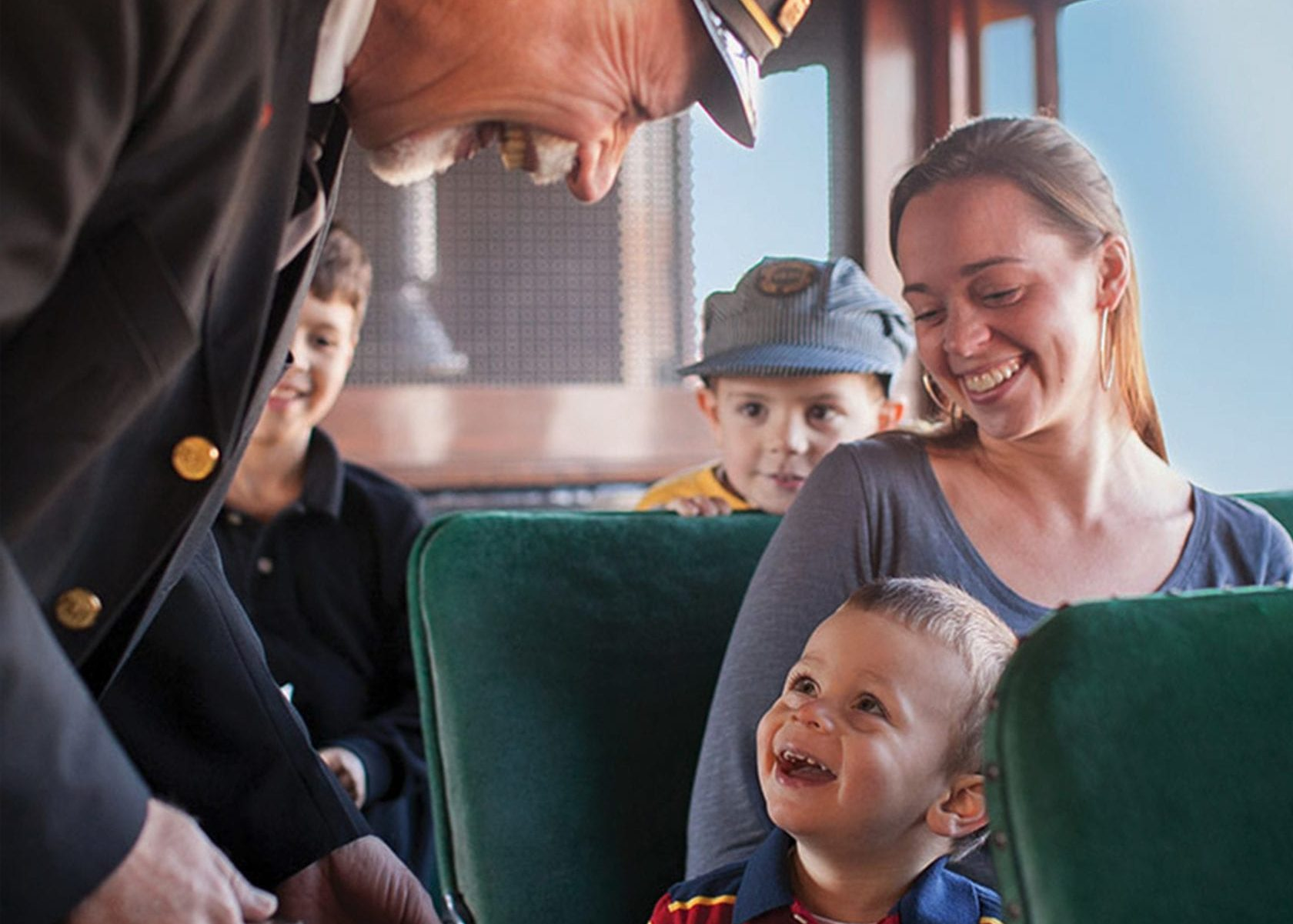 Boy and mom smiling on Strasburg Railroad train ride.